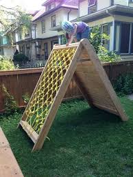 backyard climbing wall and the structure from the cargo net side backyard climbing wall ideas backyard climbing wall