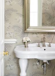 elegant small powder room design with white parisian pedestal sink polished nickel faucet silver leaf beveled mirror mint julep vase and gray wallpaper