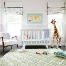 nursery with green quatrefoil rug