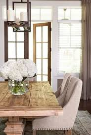 i think this will be happening in my future rustic farmhouse table paired with sleek fabric dining chairs by linda mcdougald design