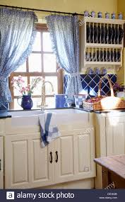 stock photo blue curtains on window curtains for kitchen window above sink simple