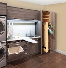 Modern laundry room features brown melamine cabinets fitted with a pull out  drawer with drying rack