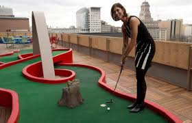 google office photos 13. Google Employee Andrea Janus Putts On A Miniputt Course Terrace In The Office Photos 13