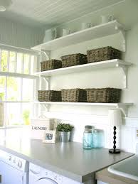 laundry room decorating in traditional style using folding table bench shelf beach inspired beach style laundry room