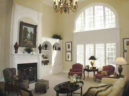this is the two story grand room with the marble fireplace and built ins