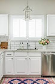 Black Granite Countertops With Tile Backsplash Stunning Chic White Kitchen Features White Cabinets Paired With White Granite