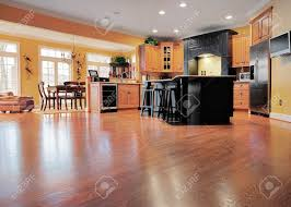 Kitchen And Dining Room Flooring Home Interior Shows A Large Expanse Of Wood Flooring In The