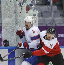Glass encasing the penalty box shatters as Austria forward Andreas Nodl  checks Norway defenseman Jonas Holos in the second period o… | Winter  olympics, Photo, Sochi