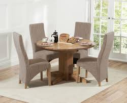 dorchester 120cm solid oak round extending dining table with henley fabric chairs