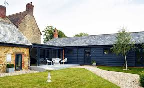 exterior finishes. barn with modern blue exterior cladding finishes s