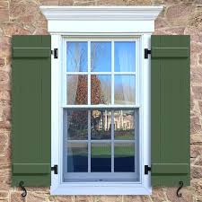 batten and board shutters window with green board and batten shutter closed boards board and batten batten and board shutters