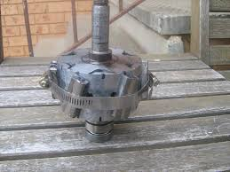 it has very little cogging now if any with 2 meter diameter blades and it spins up really easy the other picture is of the generator with the alternator