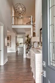 The Rosario's spacious Two Story Foyer with an Elegant Chandelier and  Beautiful Curved Staircase is Sure