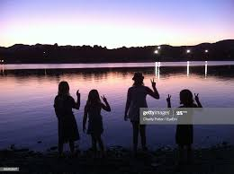 Silhouette People At Calm Lake High-Res Stock Photo - Getty Images