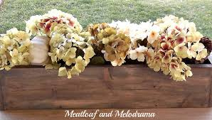 diy aged wood planter box with faux hydrangeas pine cones and white pumpkins
