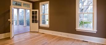 wood floor large unfurnished bedroom or diningroom with open doors to porch