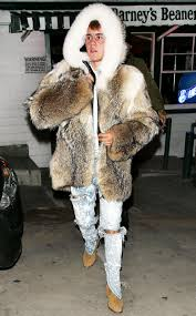 justin bieber wore a fur coat and acid wash jeans out in l a s 61 degree weather on monday december 19 and the internet can t get enough