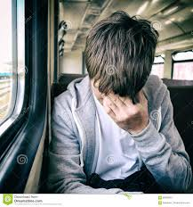 Image result for sad young man on a train