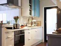 simple small kitchen ideas using slide cupboard and glass window with natural lighting