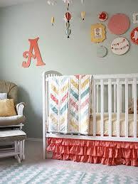 Crib with pink ruffled crib skirt