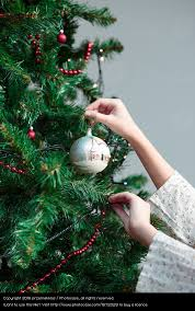 Decorating Christmas Tree With Balls Unique Young Girl Decorating Christmas Tree With Ball At Home A Royalty