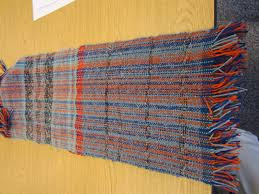 brought a few samples of rugs she crocheted out of wool cotton and t shirt strips suggested using a k hook and strips that are cut to 1 to 1 5