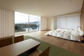 Furniture:Minimalist Bedroom With Japanese Style Bed And White Fluffy Fur  Rug And Grey Floor