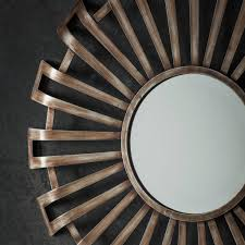 round metal starburst wall mirror