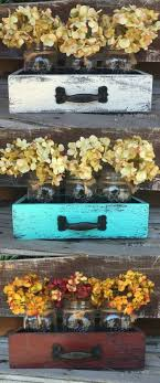 not with flowers adore use of drawers jars tho diy wooden drawers with mason jars the wood is painted and distressed for a rustic look adore diy hanging mason