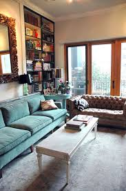 teal living room furniture. love the teal velvet sofa and gorgeous faded rug living room furniture