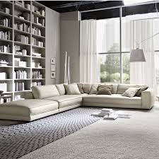 Living Room:Outstanding Living Room Design With Corner Cream Bed Sofa And  Large White Bookshelf