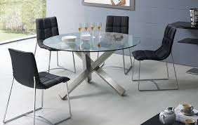 round glass dining table with unique metal base