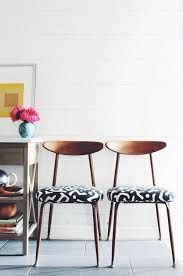 a set of six mid century modern dining room chairs with african print upholstery