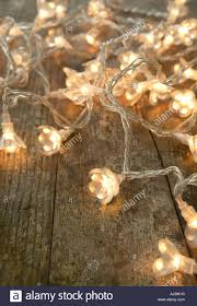 Gold Christmas Lights Lowes String Of Burning Christmas Lights On A Rustic Wooden Table
