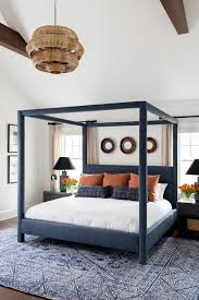 layering rugs under beds centsational