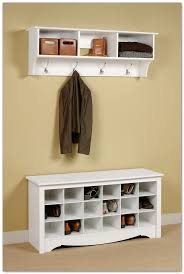 white painted wood entryway shoes storage design wall mounted shelving unit and jacket or coat hanger