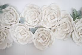 white foam flowers with leaves hung as living room decorating idea