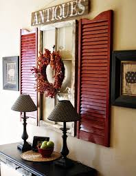 view in gallery red shutters and old window used as wall art above a hall table