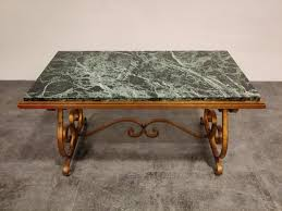 wrought iron and marble coffee table