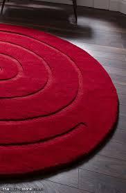 spiral round red rug