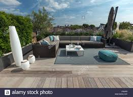 Roof deck furniture Luxury Luxurious Roof Terrace In London With Hardwood Timber Decking Contemporary Planters With Lush Planting And Modern Outdoor Furniture Newspodco Luxurious Roof Terrace In London With Hardwood Timber Decking Stock