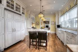 granite countertop ideas for white cabinets. country kitchen with white cabinets and hidden freezer fridge breakfast bar island granite countertop ideas for