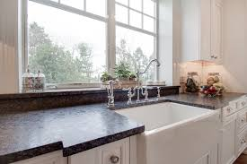 Granite Kitchens Bright White Kitchen With Silver Pearl Leathered Granite