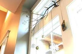 tips for how to hang garland wreaths and stockings without nails command hooks stucco strips outdoor