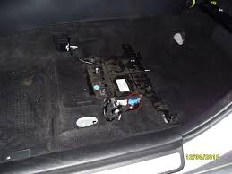 how to install an aftermarket amp and sub in your gen 1 ms3 the wires leading into the amp are going to be taped together black electrical tape and coming from a source under the carpet