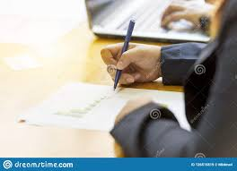 Asian Business Woman Hand Hold Pen And Write Down On Graph