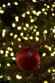 Lighted Christmas Ornaments Ball Red Christmas Ball Ornament In Lighted Christmas Tree