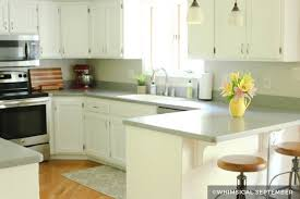 white painted kitchen cabinets with gray countertop