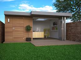 outdoor garden office. bifold doors create free flowing indoor outdoor space garden office