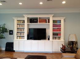 White Stained Wood Built In Book Cabinet With Shelf And TV Stand. Minimalist
